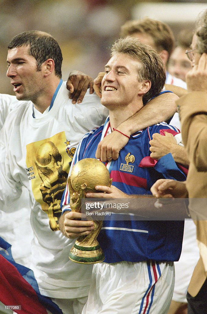 France captain Didier Deschamps celebrates with the trophy after victory in the World Cup Final against Brazil at the Stade de France in St Denis. France won 3-0. \ Mandatory Credit: Ben Radford /Allsport
