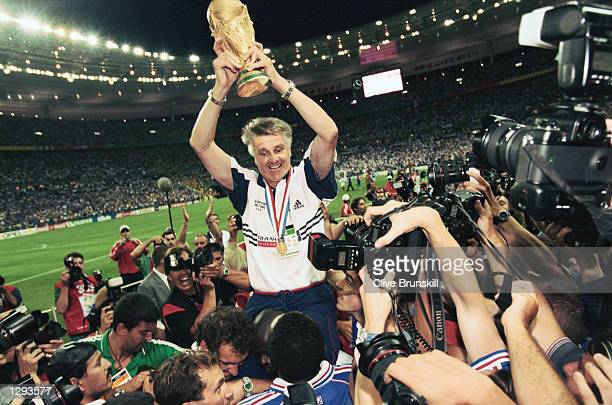 France coach Aime Jacquet lifts the trophy after victory in the World Cup Final against Brazil at the Stade de France in St Denis France won 30...