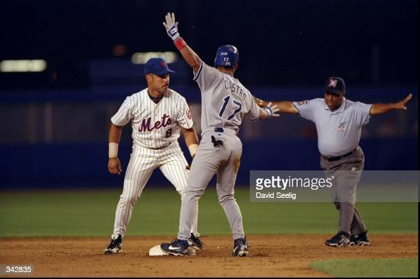 Infielder Carlos Baerga of the New York Mets in action against infielder Juan Castro of the Los Angeles Dodgers during a game at Shea Stadium in...