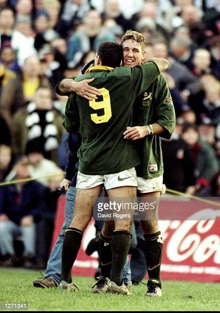 Joost Van Der Westhuizen of South Africa celebrates with team mate Gary Teichmann after the final whistle of the TriNations match against New Zealand...