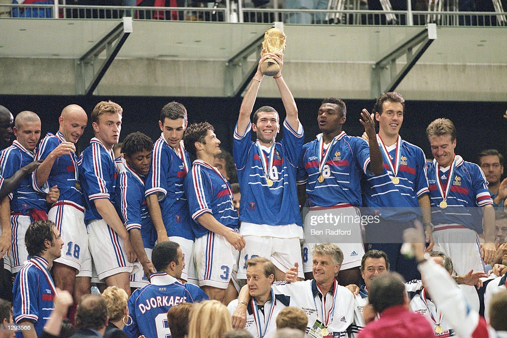 Joy for France as match winnner Zinedine Zidane lifts the trophy after victory in the World Cup Final against Brazil at the Stade de France in St...