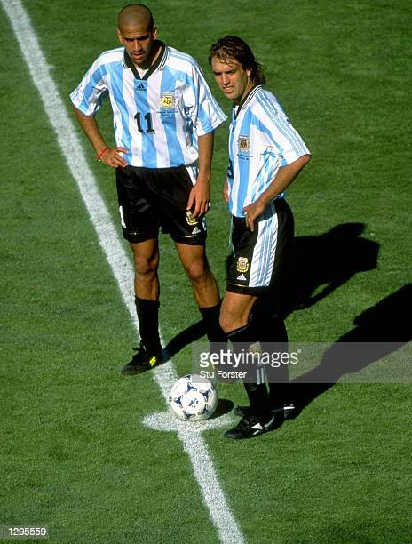 Juan Veron and Gabriel Batistuta of Argentina prepare for kickoff in the World Cup quarterfinal match against Holland at the Stade Velodrome in...