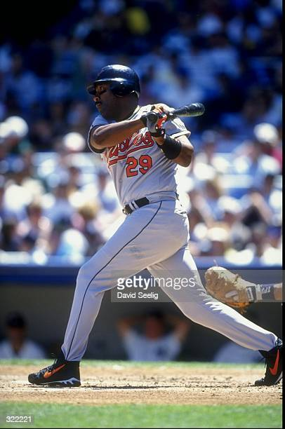 Outfielder Joe Carter of the Baltimore Orioles in action during a game against the New York Yankees at the Yankee Stadium in the Bronx New York The...