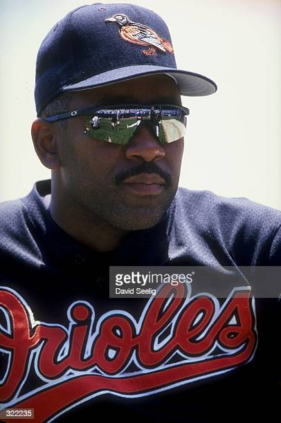 Outfielder Joe Carter of the Baltimore Orioles looks on during a game against the New York Yankees at the Yankee Stadium in the Bronx New York The...