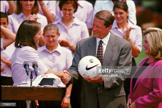 Brandi Chastain of the Team USA presents a soccer ball to Vice President of the United States of America Al Gore at the White House in Washington DC...