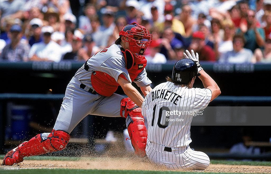 Catcher Eli Marrero # 26 of the St. Louis Cardinals tags Dante Bichette #10 of the Colorado Rockies at the Coors Field in Denver, Colorado. The Cardinals defeated the Rockies 10-6. Mandatory Credit: Brian Bahr /Allsport