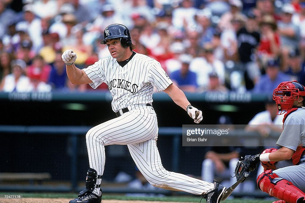 Dante Bichette #10 of the Colorado Rockies drops his bat during the game against the St. Louis Cardinals at the Coors Field in Denver, Colorado. The Cardinals defeated the Rockies 10-6. Mandatory Credit: Brian Bahr /Allsport