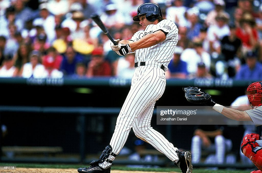 Dante Bichette #10 of the Denver Rockies swings at the ball during the game against the St. Louis Cardinals at the Coors Field in Denver, Colorado. The Cardinals defeated the Rockies 10-6. Mandatory Credit: Jonathan Daniel /Allsport
