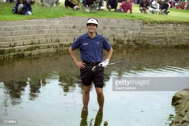 Jean Van de Velde of France still smiling despite finding the Barry Burn with his third shot on the final hole of the British Open at Carnoustie in...