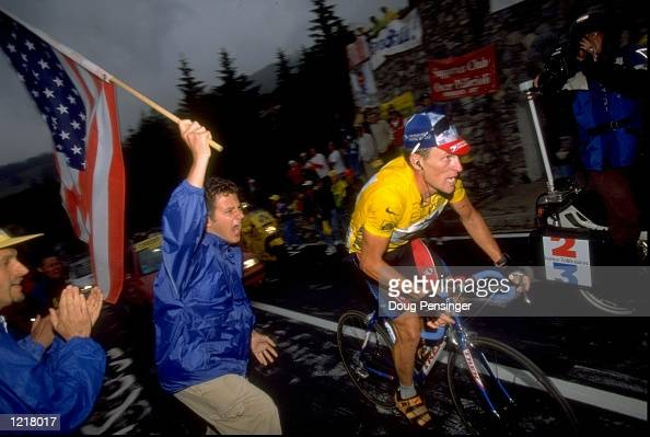 Lance Armstrong of the USA and Team USP cheered on by a patriotic fan during Stage 9 of the Tour de France between Le GrandBornand and Sestrieres...