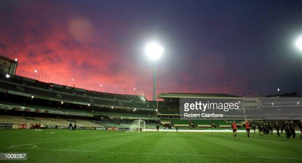 Manchester United players take in the view of the Melbourne Cricket Ground during training for the Sharp Challenge Cup to be played between the...