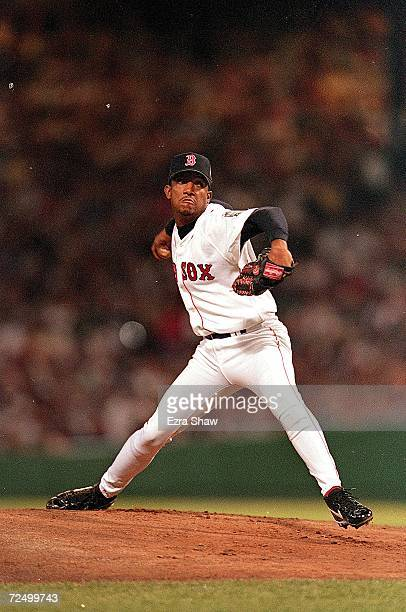 Pedro Martinez of the American League Team winds back to throw during the 1999 MLB AllStar Game against the National League Team at Fenway Park in...