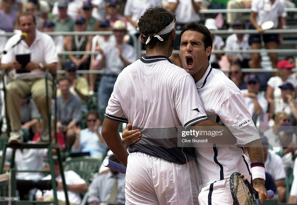 Alex Corretja of Spain celebrates with team-mate Juan Balcells during the third rubber match against Todd Martin and Chris Woodruff of the USA in the Davis Cup semi-final between the USA and Spain in Santander, Spain. Mandatory Credit: Clive Brunskill/ALLSPORT