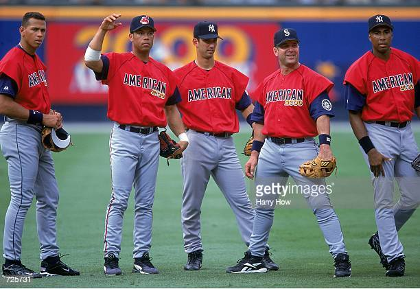 Alex Rodriguez Roberto Alomar Jorge Posada Edgar Martinez and Bernie Williams who play for the American League stand on the field during the AllStar...