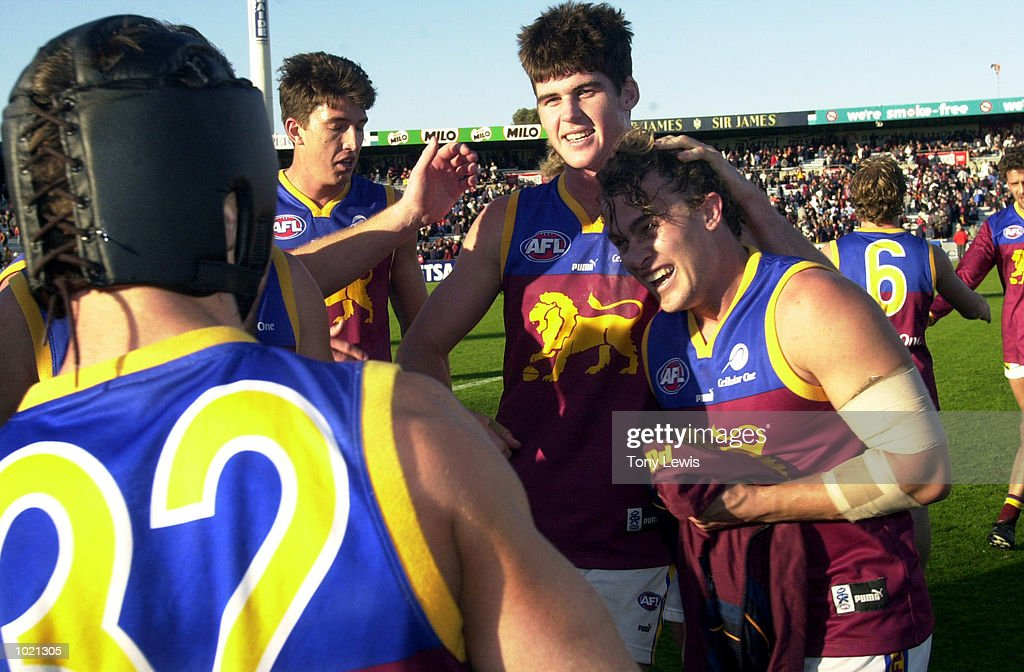 Brisbane players celebrate their victory in the match between the Adelaide Crows and the Brisbane Lions in round 20 of the AFL played at Football Park in Adelaide, Australia. Brisbane 17.13 (115) defeated Adelaide 11.12 (78) Digital Image. Mandatory Credit: Tony Lewis/ALLSPORT