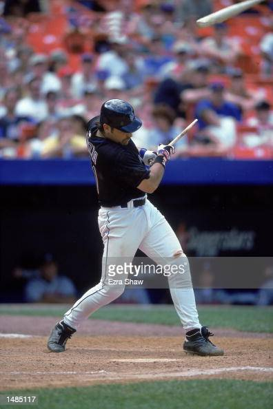 Catcher Mike Piazza of New York Mets breaks his bat while hitting the ball during the game against the Atlanta Braves at Shea Stadium in Flushing New...