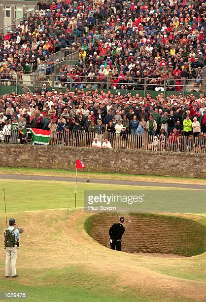 David Duval of the USA finds the Road Hole Bunker on the 17th hole during the final round of the British Open on the Old Course at St Andrews in...