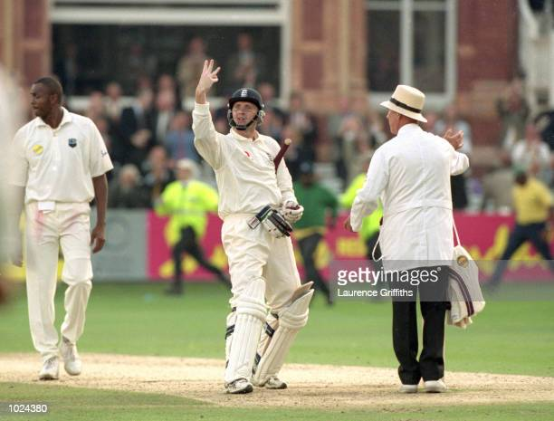 Dominic Cork of England celebrates the winning runs during the third day's play of the England v West Indies second Cornhill test match at Lord's...