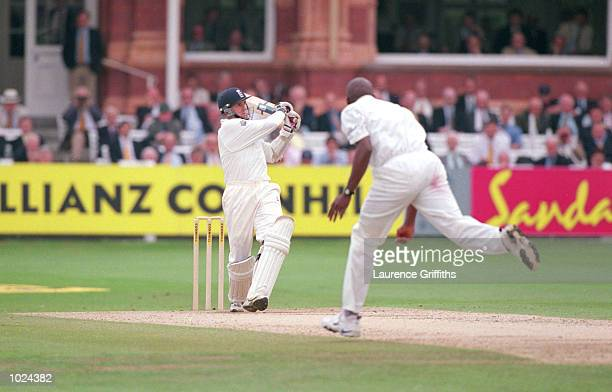 Dominic Cork of England hits the six off Franklyn Rose of West Indies during the third day's play of the England v West Indies second Cornhill test...