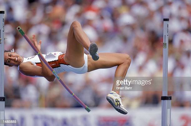 Erin Aldrich of the US leaps over the bar in the Womens High Jump Event during the 2000 US Olympic Track Field Team Trials at the Hornet Stadium in...