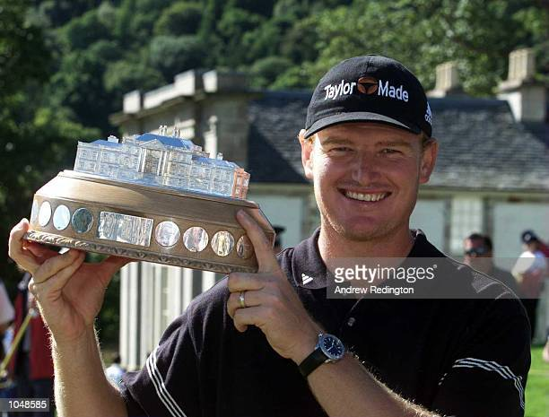 Ernie Els of South Africa poses with the trophy after winning the Standard Life Loch Lomond Tournament at Loch Lomond GC Glasgow Scotland Mandatory...