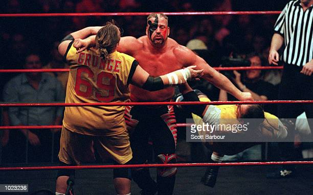 ''Hawk'' of The Road Warriors clothes lines ''Public Enemy'' during their fight at the Superstars Of Wrestling Event held at the Sydney Superdome...