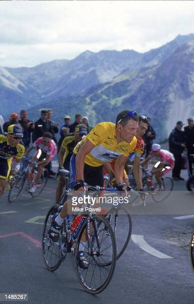 Lance Armstrong of the US Postal Service Team wears the Yellow Jersey while he rides with the pack during Stage 14 Draguignan to Briancon France of...