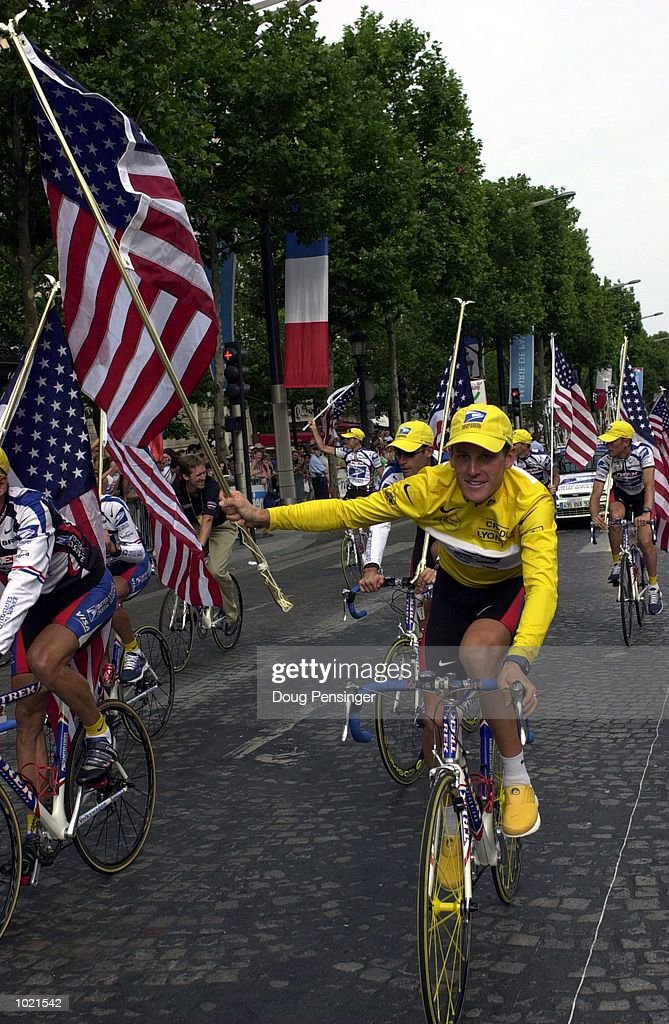 Lance Armstrong of the USA and the US Postal team celebrates winning the 2000 Tour De France, France. Mandatory Credit: Doug Pensinger/ALLSPORT