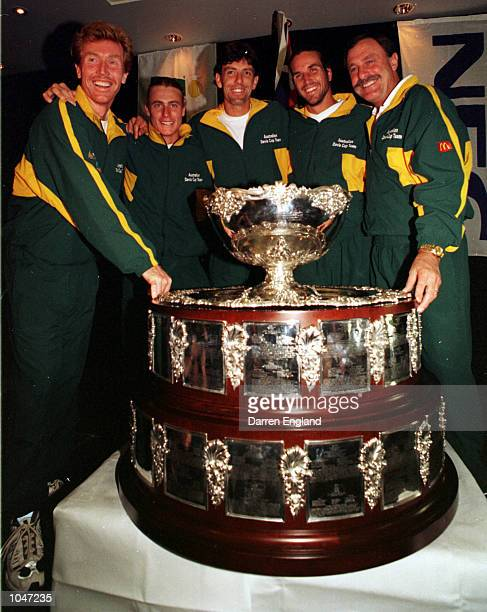 Left to right Mark Woodforde Lleyton Hewitt Sandon Stolle Patrick Rafter and captain John Newcombe of Australia pose with the Davis Cup during a...