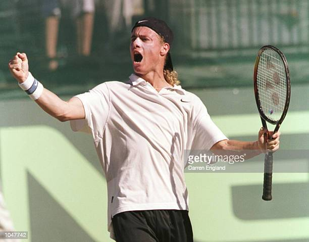 Lleyton Hewitt of Australia celebrates his 64 62 63 victory over Fernando Meligeni of Brazil during the NEC Davis Cup semi final between Australia...