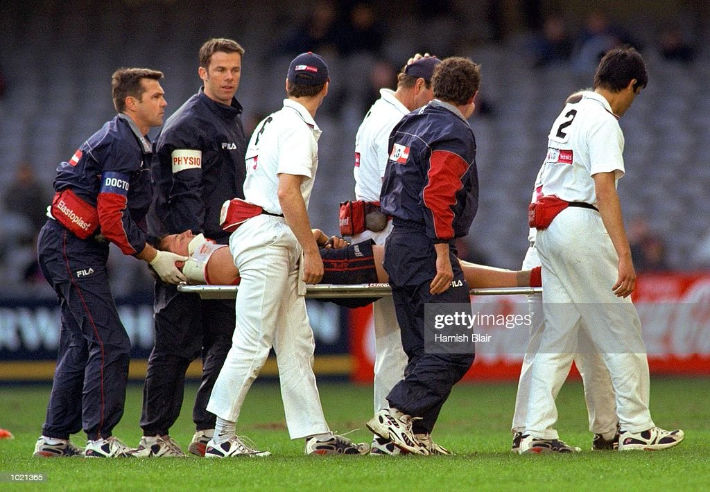 Nathan Brown #25 for Melbourne is carried from the ground after becoming injured in the match between the Melbourne Demons and the Fremantle Dockers, during round 20 of the AFL season played at Colonial Stadium in Melbourne, Australia. Mandatory Credit: Hamish Blair/ALLSPORT