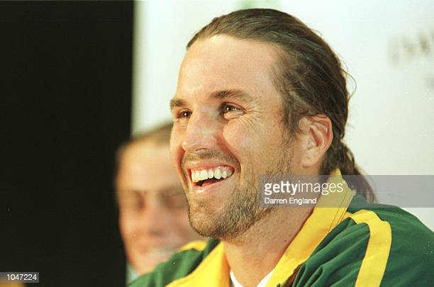Patrick Rafter of Australia smiles during a press conference held at the Marriott Hotel in Brisbane ahead of the NEC Davis Cup semi final between...
