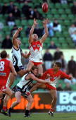 Paul Kelly for Sydney takes a high mark over Scott Burns for Collingwood in the match between the Collingwood Magpies and the Sydney Swans during...