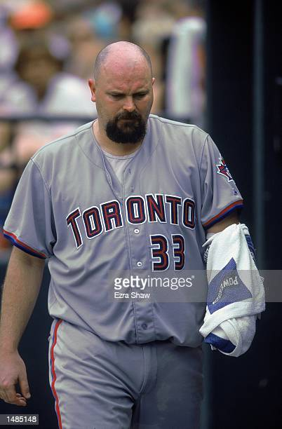 Pitcher David Wells of Toronto Blue Jays keeping his throwing arm warm during the game against the Baltimore Orioles at Camden Yards in Baltimore...