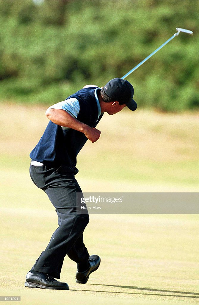 Tiger Woods of the USA celebrates after holling his putt on the 13th green during the third round of the British Open Golf Championships at the Old Course, St Andrews, Scotland. Mandatory Credit: Harry How/ALLSPORT