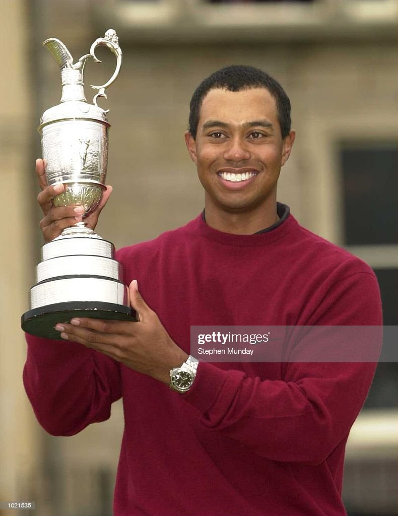 Tiger Woods of the USA holds the claret jug after victory in the 2000 British Open Golf Championships at the Old Course, St Andrews, Scotland. Mandatory Credit: Stephen Munday/ALLSPORT
