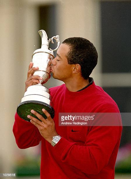 Tiger Woods of the USA kisses the Claret Jug after winning the British Open on the Old Course at St Andrews in Scotland Woods finished 19 with a...