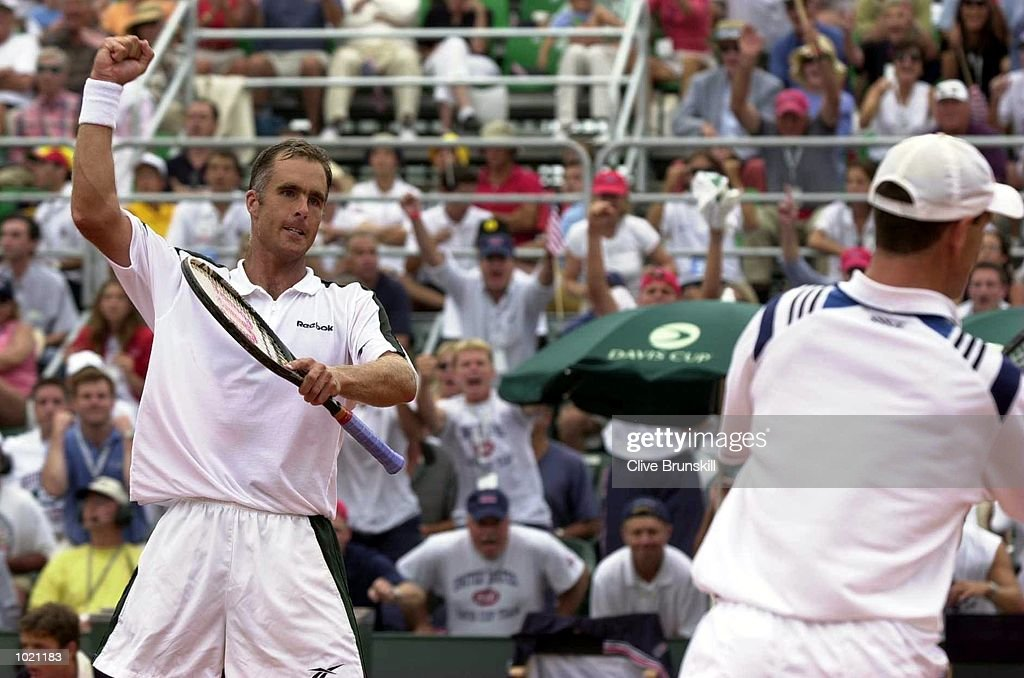 Todd Martin and Chris Woodruff of the USA celebrate after winning the fourth set in the doubles and third rubber against Alex Corretja and Juan Balcells of Spain in the Davis Cup semi-final between the USA and Spain in Santander, Spain. Mandatory Credit: Clive Brunskill/ALLSPORT