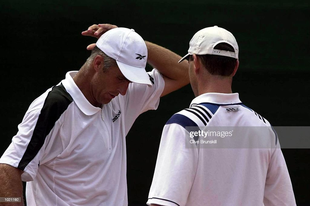 Todd Martin and Chris Woodruff of the USA show their dejection during the doubles and third rubber which they lost in five sets against Alex Corretja and Juan Balcells of Spain at the Davis Cup semi-final between the USA and Spain in Santander, Spain. Mandatory Credit: Clive Brunskill/ALLSPORT