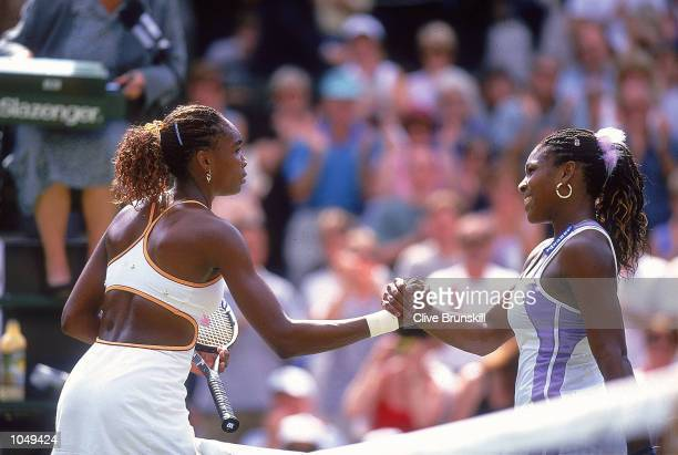 Venus Williams of the USA beats younger sister Serena during the semi final game at the Wimbledon Lawn Tennis Championship at the All England Lawn...
