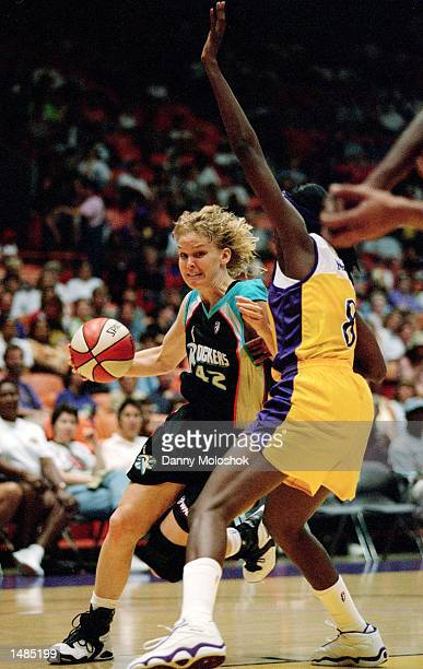 Vicki Hall of the Cleveland Rockers dribbles the ball as she is guarded by DeLisha Milton of the Los Angeles Sparks at the Great Western Forum in...