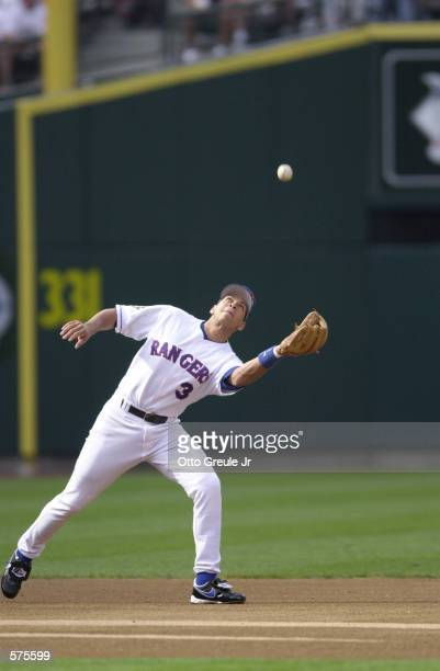 Alex Rodriguez of the Texas Rangers catches a popup while playing third base for the American League during the 2001 Major League Baseball AllStar...