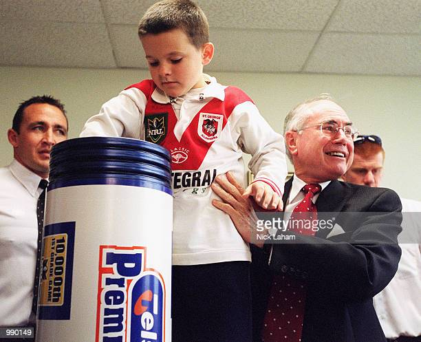 Australian Prime Minister John Howard and a St George Illawarra Dragons fan put together a time capsule at the NRL press conference for the NRL's...