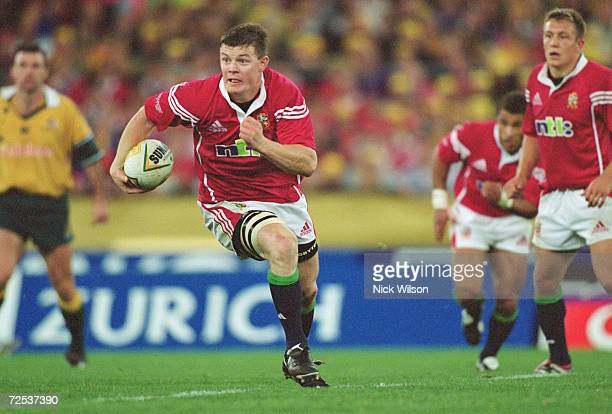 Brian O''Driscoll of the British Lions runs with the ball during the Third Test match against Australia played at Stadium Australia in Sydney...