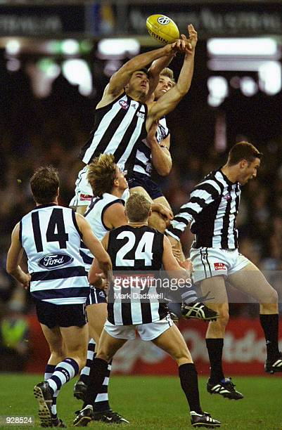 Chris Tarrant of Collingwood attempts to mark over a pack of players during the round 14 AFL match between the Geelong Cats and the Collingwood...
