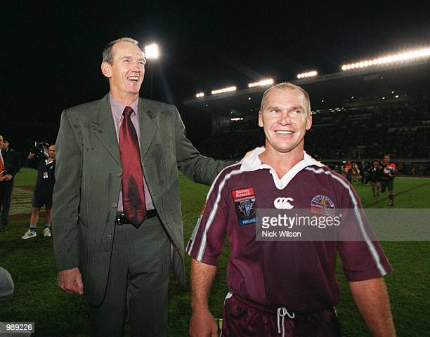 Coach Wayne Bennet congratulates Allan Langer of QLD after winning the third and final State of Origin match between NSW Blues v QLD Maroons at ANZ...