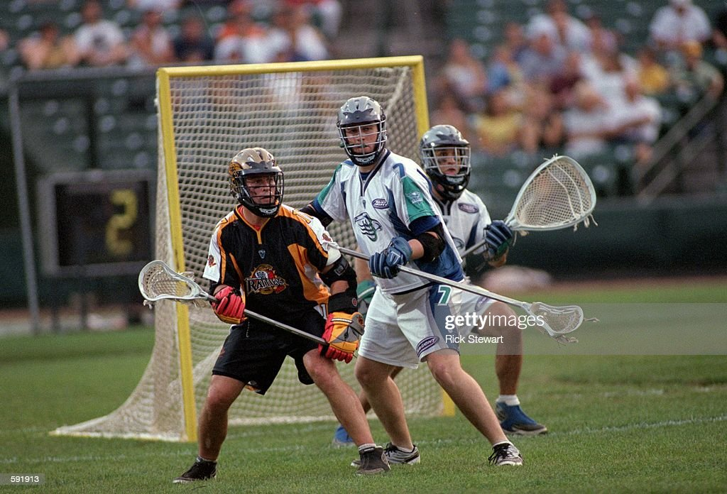 D''arcy Sweet of the Rochester Rattlers and Matt Dwan and Greg Cattrano of the Baltimore Bayhawks are ready by the goal during the game at Frontier...
