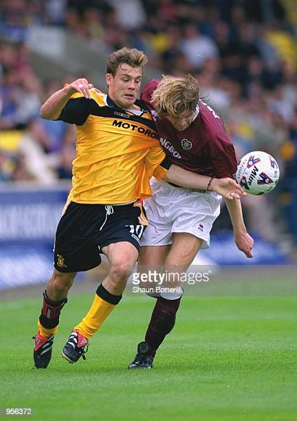 David Fernandez of Livingston tries to take the ball past Steven Pressley of Hearts during the Scottish Premier Division match played at Almondvale...