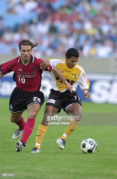 Diego Gutierrez of the Chicago Fire fights Ariel Graziani of the Dallas Burn for possession of the ball during the match at Soldier Field in Chicago...