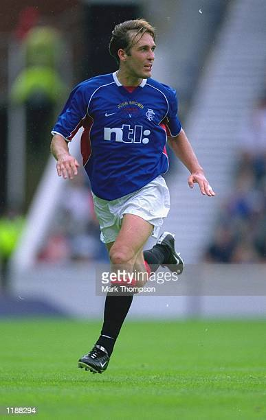 Fernando Ricksen of Rangers in action during John Brown Testimonial match against Anderlecht played at Ibrox in Glasgow Scotland Anderlecht won the...
